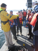 Jonathan Kellogg, OIP volunteer and UW graduate student, conducts research on Puget Sound with marine volunteers