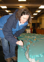 A workshop participant working with a model of currents in Puget Sound
