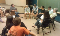 Speakers engage in fish-bowl format discussion