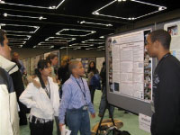 High school apprentices presenting their research poster at the 2010 Ocean Science Meeting