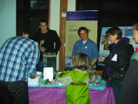 Seattle Aquarium guests participating in the School of Oceanography's popular display The Great Plankton Race