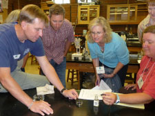Dr. Jude Apple, SPMC, and community college faculty work on an ocean acidification lab activity