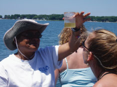 COSEE Coastal Trends Co-PI Deidre Gibson demonstrates plankton collection to Institute participants