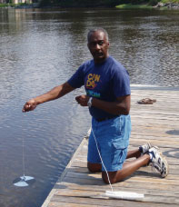 Lemuel Patterson takes Secchi disc information in a Georgia tidal creek during '09 Coastal Legacy