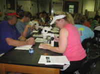 Teacher Wanda Hamilton and Carol Pride of Savannah State University use core samples to observe sediment climate changes at the 2009 Ocean Science Education Leadership Institute
