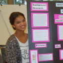 Student presenting a poster
