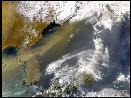 A satellite image tracks a dust cloud moving east over the Korean Peninsula into the Sea of Japan (the white patches are clouds).